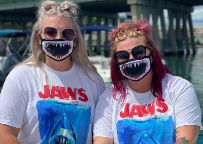 An image of Florida Shark Diving guests in shark masks at the dock.